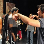 Choreographer Paul Nygro rehearses a musical number with the cast.