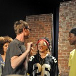 Director, Liam Sullivan goes over a musical number with (l-r) actors Vanessa Bryan, Margaret Cho, and Andre Darnell Myers.