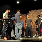 Choreographer, Paul Nygro rehearses a musical number with the cast.